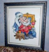 "Cross stitch pattern ""Santa's Workshop""."