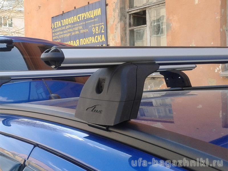 Багажник на крышу Kia Sportage 2016-..., Lux, аэродинамические дуги (53 мм) на интегрированные рейлинги