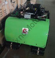 БТС- 2x2 15ER (18A/216Вт) двухгусеничный мотобуксировщик мощностью 15 л. с., с задним ходом, реверс-редуктором, дисковым тормозом и полным электропакетом.