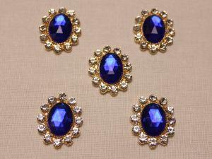 Кабошон со стразами, овал, цвет основы: золото, цвет стразы: синий, размер: 23х19мм (1уп = 10шт)