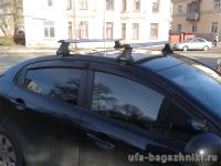 Багажник на крышу Kia Rio (c 2011г, sedan / hatchback), Атлант, крыловидные дуги