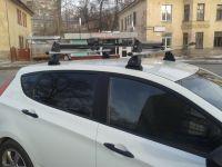 Багажник на крышу Hyundai Solaris hatchback 2011-17, Lux, аэродинамические дуги 53 мм