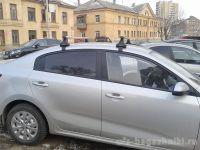Багажник на крышу Kia Rio (c 2017г, sedan), Атлант, аэродинамические дуги