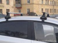 Багажник на крышу Hyundai Solaris (с 2017г, sedan), Атлант, аэродинамические дуги, опора E