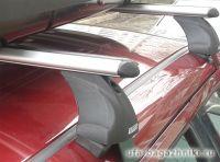 Багажник на крышу Skoda Fabia MK2 hatchback, Атлант, аэродинамические дуги, опора Е