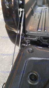 Механизм плавного открывания заднего борта