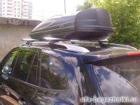 Багажник на крышу Hyundai Santa Fe 2007-..., Атлант, крыловидные дуги на рейлинги