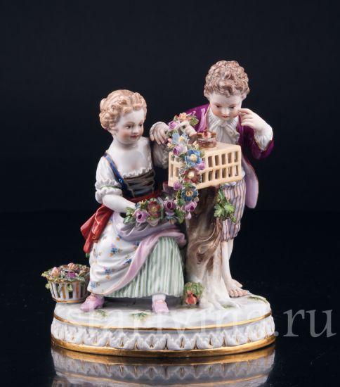 Антикварная старинная фарфоровая статуэтка Пара с птичьей клеткой, аллегория весны производства Meissen, Германия, 19 в.