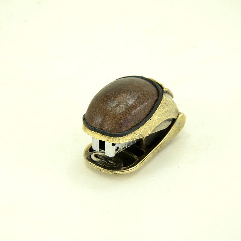 Маленький бронзовый степлер