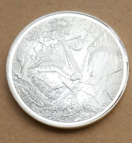 Коллекционная монета Пираты Карибского Моря