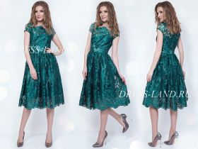 Зеленое коктейльное платье длины миди
