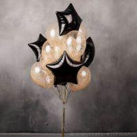 Прозрачные шарики с золотыми блестками и черными звездами