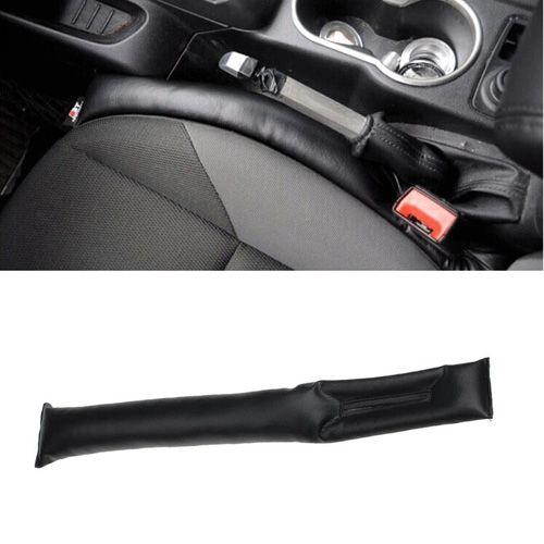 Автомобильная ловушка между сиденьем и консолью.