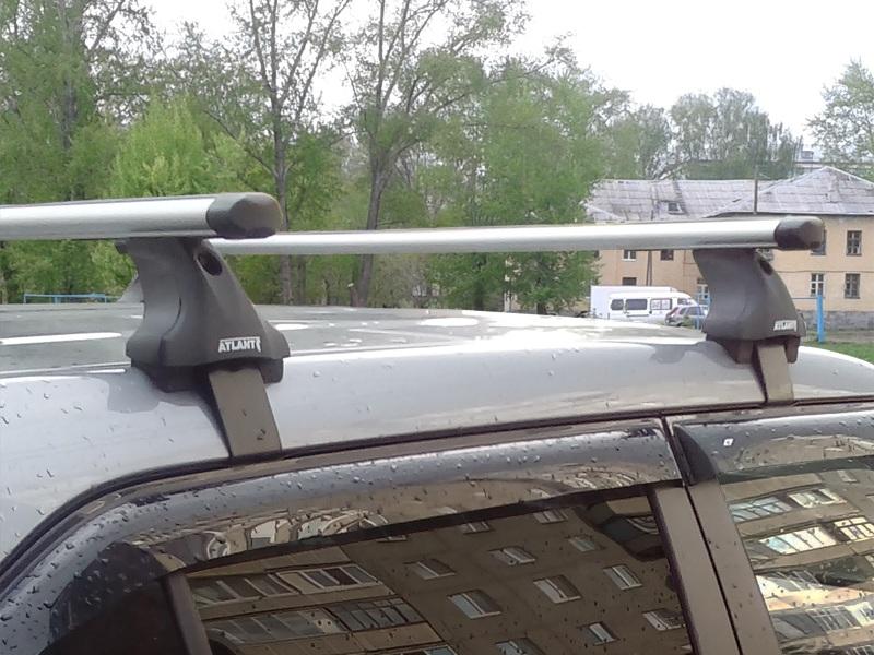 Багажник на крышу Lada XRay, Атлант, аэродинамические дуги Эконом, опора Е