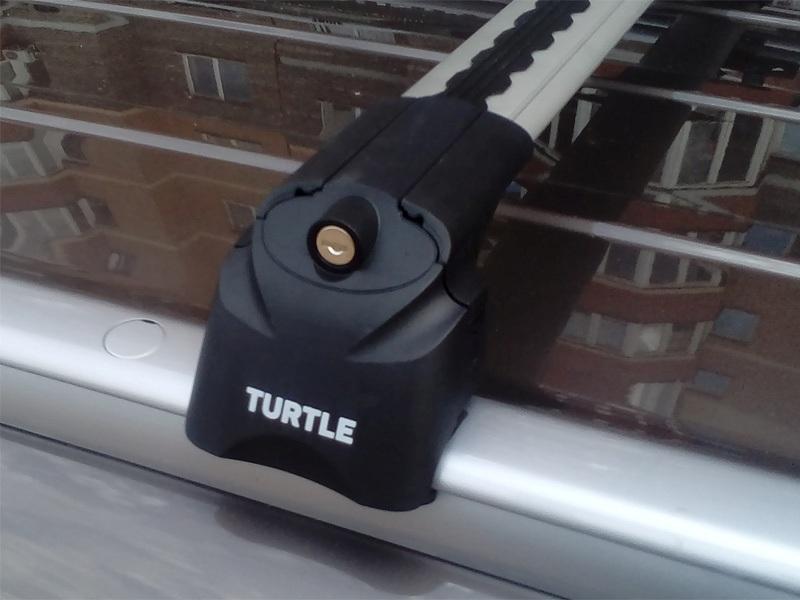 Багажник на крышу Mitsubishi ASX, Turtle Air 2, аэродинамические дуги на интегрированные рейлинги (серебристый цвет)
