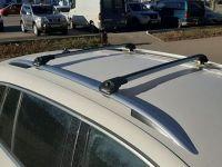 Багажник на крышу Volkswagen Tiguan, аэродинамические дуги на рейлинги (серебристый цвет)