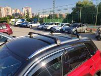 Багажник на крышу Suzuki Vitara 2015-..., Turtle Air 2, аэродинамические дуги на интегрированные рейлинги (черный цвет)