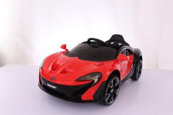 Машина красная на р/у 2,4ГГц, плеер USB/MP3, руль с регулировкой, двери открываются, 4 подвески, аккумулятор 12В 4.5А, 2 мотора, функция поворота