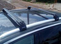 Багажник на крышу Peugeot 3008 2016-..., Turtle Air 2, аэродинамические дуги на интегрированные рейлинги (черный цвет)