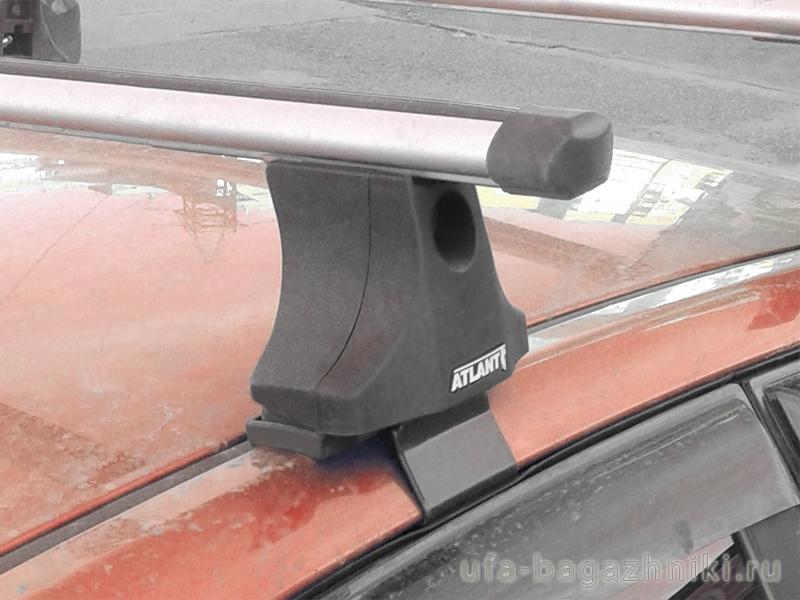 """Багажник на крышу Kia Spectra, Атлант, аэродинамические дуги """"Эконом"""""""