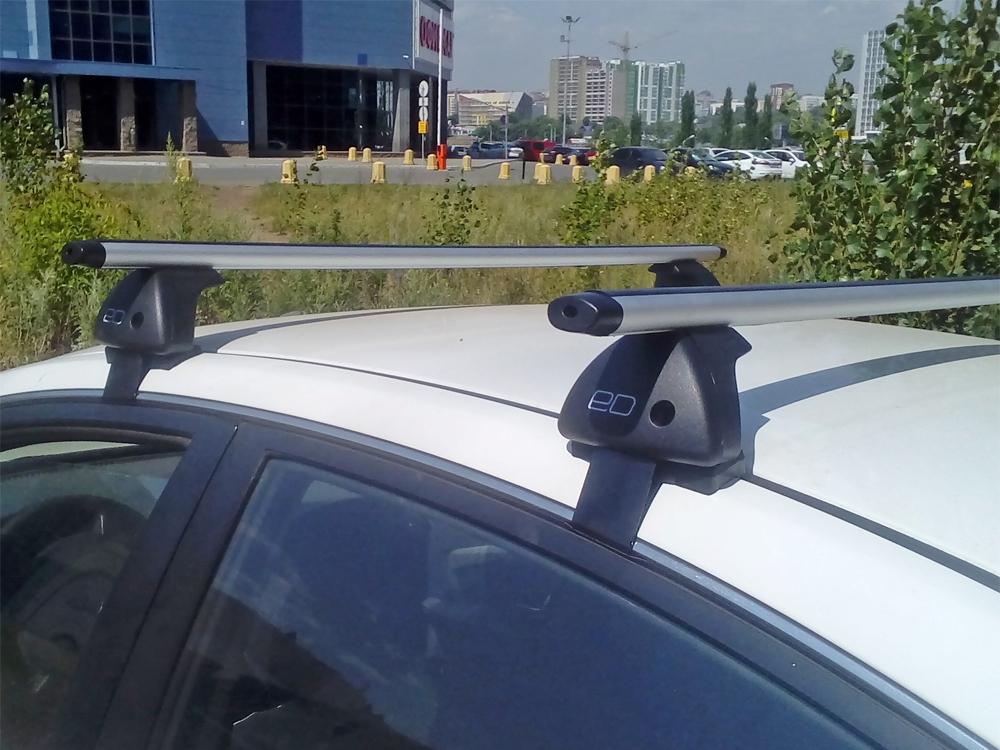 Багажник на крышу Kia Rio 2017-..., sedan, Евродеталь, аэродинамические дуги