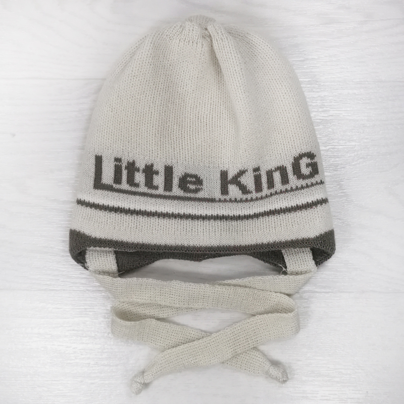 зн1023-01 Шапка вязаная на завязках с отворотом Little King бежевая