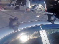 Багажник на крышу Chevrolet Aveo 2002-11 sedan/hatchback, Евродеталь, аэродинамические дуги