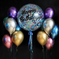 """Большой шар с надписью """"С Днём Рождения!"""" и два фонтана из хромированных шариков."""