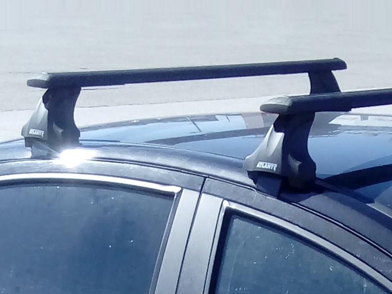 Багажник на крышу Hyundai Solaris (2011-17), sedan, Атлант, крыловидные аэродуги (черный цвет)