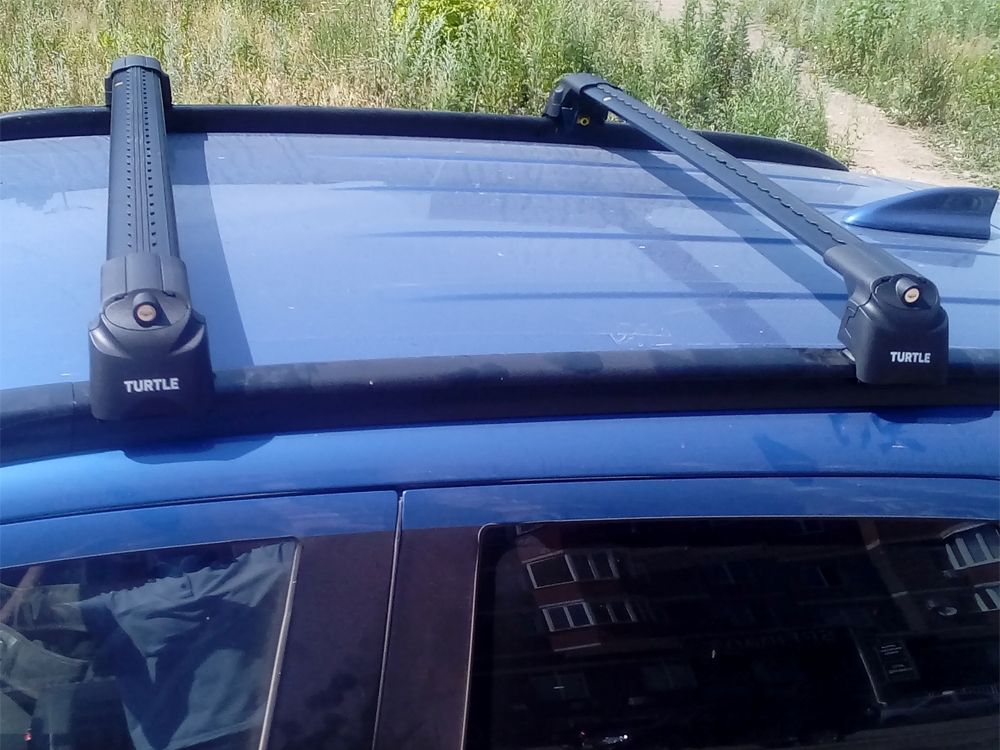 Багажник на крышу Hyundai Tucson 2016-..., Turtle Air 2, аэродинамические дуги на интегрированные рейлинги (черный цвет)
