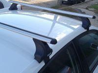 Багажник на крышу Volkswagen Polo 2020-..., Атлант, аэродинамические дуги