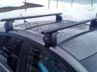 Багажник на крышу Volkswagen Polo sedan 2010-20, Евродеталь, аэродинамические дуги (черный цвет)