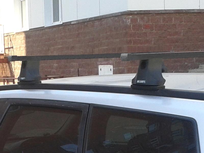 Багажник на крышу Nissan Wingroad, Атлант, стальные прямоугольные дуги (в пластике)