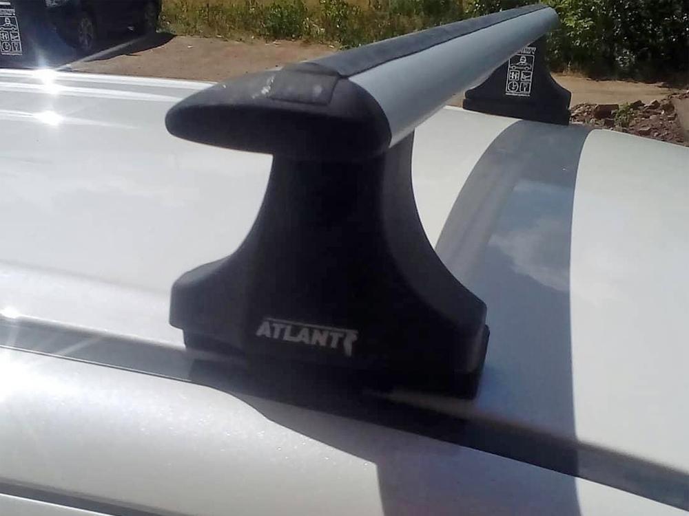 Багажник на крышу Mitsubishi ASX 2011-..., со штатными местами (планки под зацеп), Атлант, крыловидные дуги
