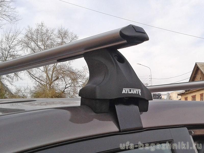 Багажник на крышу на Mitsubishi L200 2007-15, Атлант, аэродинамические дуги, опора Е