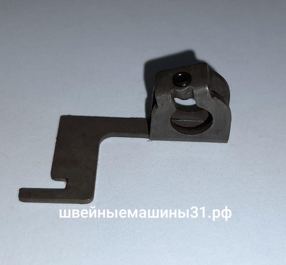 Деталь игловодителя (ограничитель нитевдевателя)     Цена 150 руб