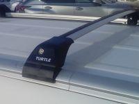 Багажник на интегрированные рейлинги Kia Soul, Turtle Tourmaline V2, крыловидные дуги (серебристый цвет)