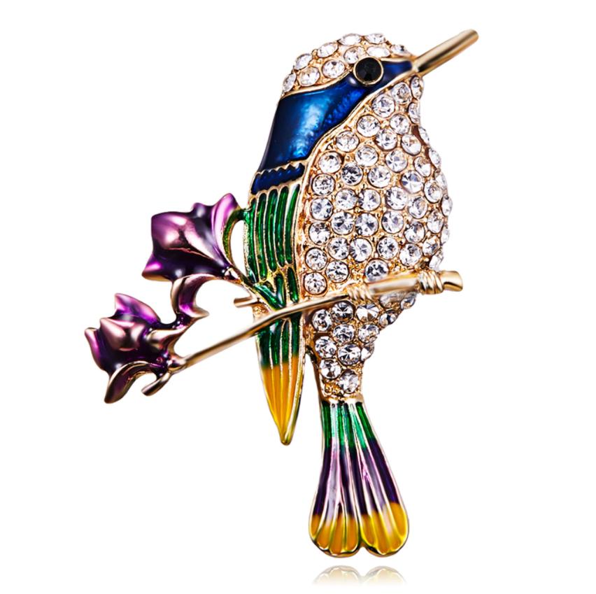 Брошь металл  со стразами и эмалью Птичка на магнолии (ROS08)