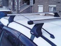 Багажник на крышу Nissan Wingroad Y12, Атлант, аэродинамические дуги Эконом, опора Е