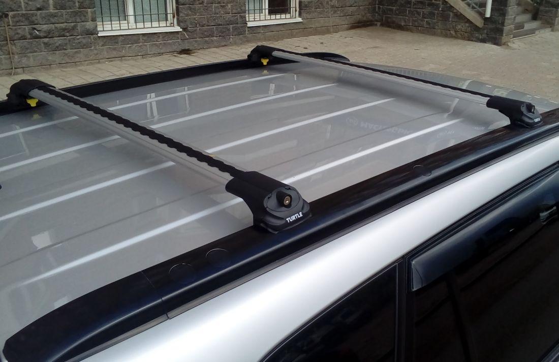 Багажник на крышу Suzuki Grand Vitara 2005-14, Turtle Air 1, аэродинамические дуги на интегрированные рейлинги (серебристый цвет)
