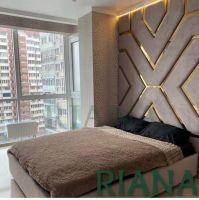 Кровать с мягкой стеновой панелью