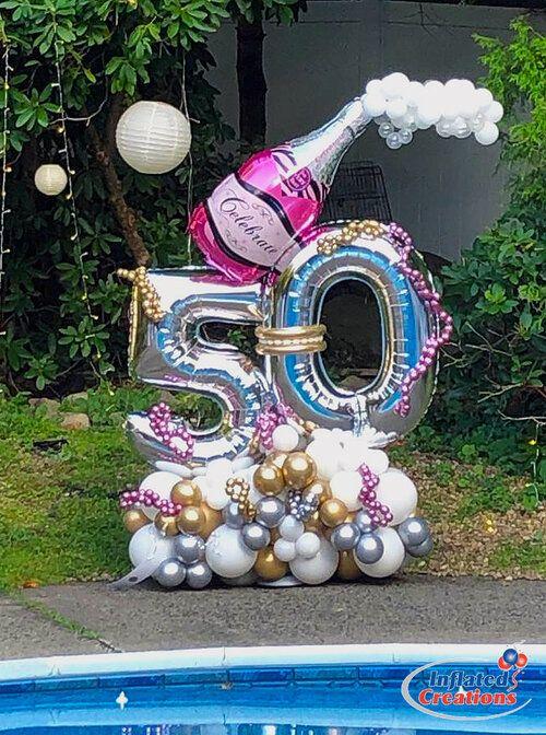 Композиция из шаров с 2 цифрами и шаром шампанское