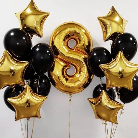 Композиция из черно-золотых фонтанов гелиевых шаров и цифры