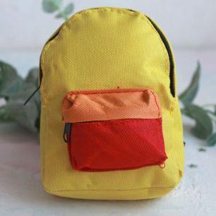 Кукольный аксессуар - Рюкзак для куклы тканевый Желтый, 13 см