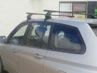 Багажник на крышу SsangYong Kyron (без рейлингов), Lux, прямоугольные стальные дуги